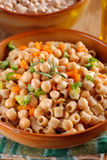 Pasta with chickpeas and vegetables Royalty Free Stock Image