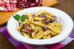 Pasta with chicory and bacon Stock Photo