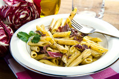 Pasta with chicory Stock Photos