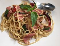 Pasta with chilli bacon. Spaghetti with chilli and bacon stock photos