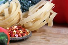 Pasta and chilly flakes. Beautiful shot of pasta and chilly flakes royalty free stock photo