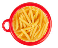 Pasta in a circular bank of red o Royalty Free Stock Images