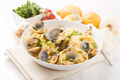 Pasta with Clams on white background Royalty Free Stock Photos