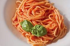 Pasta. Classic tomato spaghetti with basil Royalty Free Stock Photography