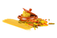 Pasta and a clay pot Stock Image