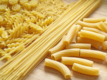 Pasta. Close up pasta on wooden dask Royalty Free Stock Photos