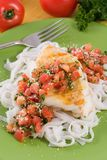 Pasta and cod with tomato pesto Royalty Free Stock Photography