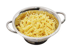 Pasta in the colander. On white background Stock Image