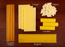 Pasta collection 4. Italian pasta collection on wooden background with labels Stock Images