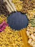 Pasta collection frame. Photo of twelve different pasta types arranged on a slate surface as a frame Royalty Free Stock Photography