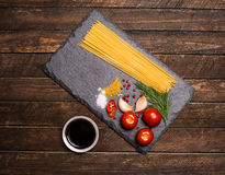 Pasta collection with fresh ingredients on slate board on rustic Royalty Free Stock Photos