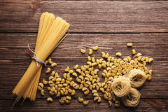 Pasta collection on rustic wooden background. Pasta collection on brown wooden background Stock Images