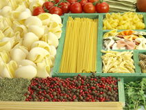 Pasta collection in wooden box and ingredients Stock Photography