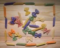 Pasta colorata dipinta nella spazzola differente di colore Immagini Stock Libere da Diritti