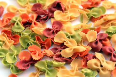 Pasta - colored farfalle stock image