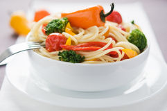 Pasta with colorful vegetables Stock Photos