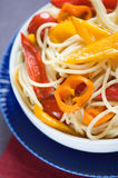 Pasta with colorful vegetables Stock Photo