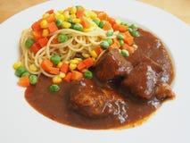 Pasta con carne di maiale arrostita Immagine Stock