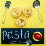 Pasta concept,, Tagliatelle before cooking stock photo