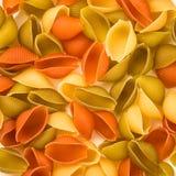 Pasta Conchiglie colorata  texture background Stock Photos