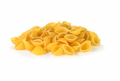 Pasta Conchiglie. Pile of pasta Conchiglie on a white background Royalty Free Stock Photography