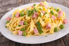 Pasta cooked with pea and ham Stock Photography