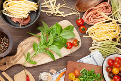 Pasta cooking ingredients and utensils on table Royalty Free Stock Photos