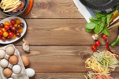 Pasta cooking ingredients and utensils on table Royalty Free Stock Image