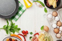 Pasta cooking ingredients and utensils on table Royalty Free Stock Photography