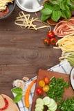 Pasta cooking ingredients and utensils Stock Photos