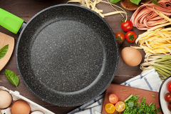 Pasta cooking ingredients and utensils Royalty Free Stock Images