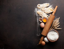 Pasta cooking ingredients. On wooden kitchen table. Top view with space for your text Stock Photo