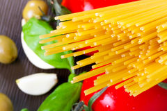 Pasta for cooking Italian. Pasta with tomatoes, garlic and basil for Italian cooking Stock Image