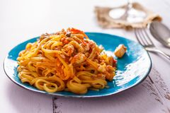Pasta with crab on blue ceramic plate. Italian Cuisine. Horizontal Royalty Free Stock Photos