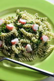 Pasta with crab sticks. Pasta fussili with crab sticks and spinach Royalty Free Stock Photo