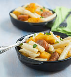 Pasta with cream sauce, italian sausage and pumpkin Stock Image