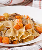 Pasta in cream sauce with slices of pumpkin and mushroom Royalty Free Stock Photography