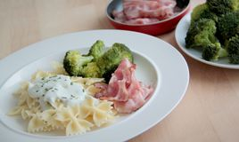Pasta with creamy cheese sauce, broccoli and roasted bacon. Pasta with roasted bacon, broccoli and cheese sauce Royalty Free Stock Photo