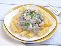 Pasta with creamy mushroom sauce and dill Stock Images