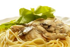 Pasta with creme mushroom sauce (path isolated). Pasta with creme mushroom sauce over macro shot (path isolated Royalty Free Stock Photo