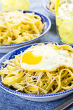 Pasta with crispy eggs Stock Photography