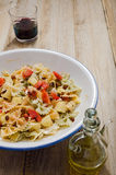 Pasta. Curly pasta dish on a rustic wood plank table Stock Images