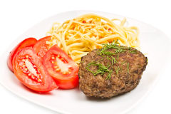 Pasta, cutlet and tomato Stock Images