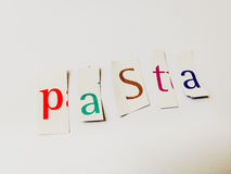 Pasta - Cutout Words Collage Of Mixed Magazine Letters with White Background. Caption composed with letters torn from magazines with White Background Royalty Free Stock Photography