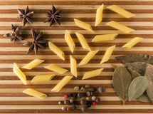 Pasta on a cutting board. Pasta and spices on a cutting board Stock Image