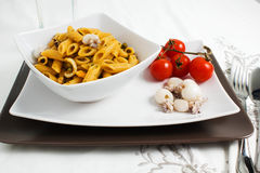 Pasta with cuttlefih. With tomatoes Royalty Free Stock Photo