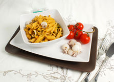 Pasta with cuttlefih. With tomatoes Stock Photos