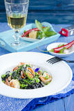 Pasta with cuttlefish ink and vegetables Stock Photography