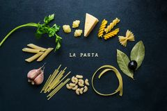 Types of pasta on a dark background royalty free stock photo