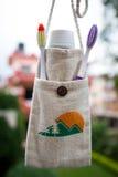Pasta de dente com escovas em um saco Fotos de Stock Royalty Free